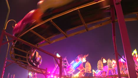 A-small-roller-coaster-at-an-amusement-park-carnival-or-state-fair-at-night-2