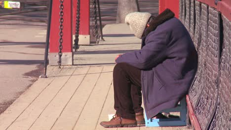 A-homeless-person-sits-on-a-bridge-in-Norway-1