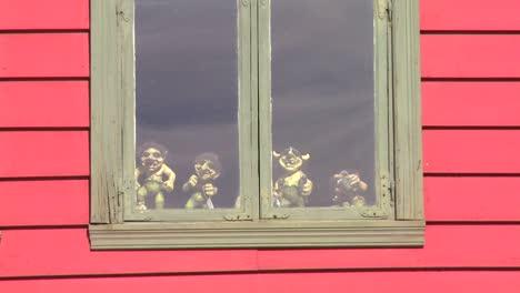 Small-troll-dolls-sit-in-a-window-in-Norway
