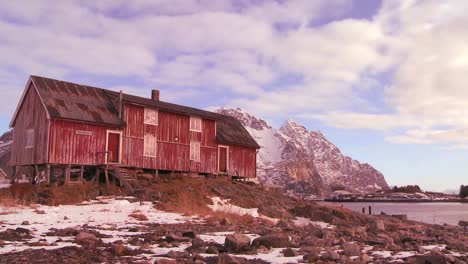 Time-lapse-of-clouds-moving-behind-a-weathered-red-fishing-village-in-the-Arctic-Lofoten-Islands-Norway