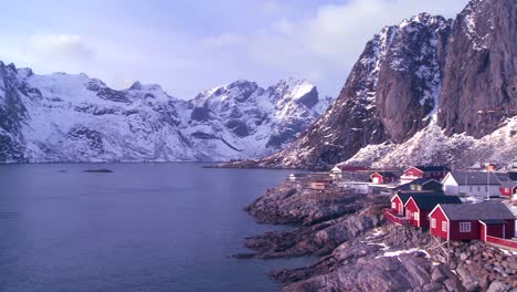 Pan-to-an-amazing-view-of-a-red-fishing-village-in-the-Arctic-Lofoten-Islands-Norway