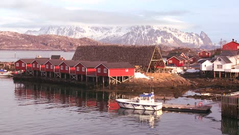 Fishing-huts-stand-in-rows-in-a-village-in-the-Arctic-Lofoten-Islands-Norway