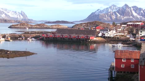 Fishing-huts-stand-in-rows-in-a-village-in-the-Arctic-Lofoten-Islands-Norway-1