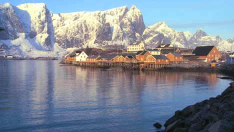 Fishing-huts-stand-in-rows-in-a-village-in-the-Arctic-Lofoten-Islands-Norway-3