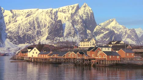 Fishing-huts-stand-in-rows-in-a-village-in-the-Arctic-Lofoten-Islands-Norway-4