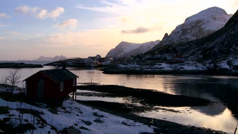 A-lonely-hut-sits-on-a-bay-in-the-Arctic-Lofoten-Islands-Norway