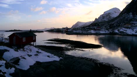 A-lonely-hut-sits-on-a-bay-in-the-Arctic-Lofoten-Islands-Norway-1