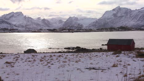 A-lonely-hut-sits-on-an-icy-bay-in-the-Arctic-Lofoten-Islands-Norway