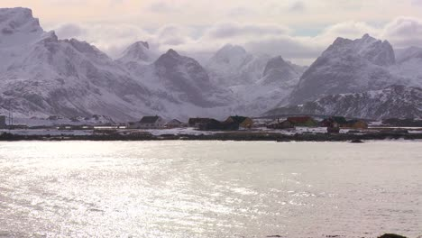 Snow-covers-a-beautiful-view-of-a-harbor-in-a-village-in-the-Arctic-Lofoten-Islands-Norway