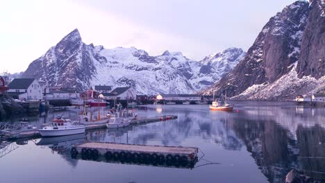 Snow-covers-a-beautiful-view-of-a-harbor-in-a-village-in-the-Arctic-Lofoten-Islands-Norway-1