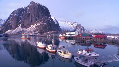 Snow-covers-a-beautiful-view-of-a-harbor-in-a-village-in-the-Arctic-Lofoten-Islands-Norway-2