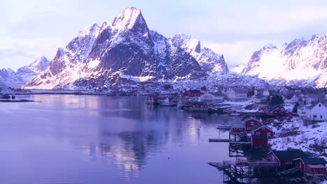Snow-covers-a-beautiful-view-of-a-harbor-and-bay-in-a-village-in-the-Arctic-Lofoten-Islands-Norway