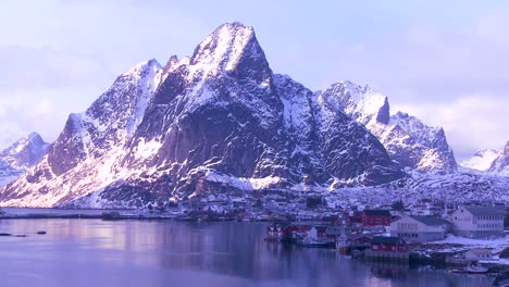 Snow-covers-a-beautiful-view-of-a-harbor-and-bay-in-a-village-in-the-Arctic-Lofoten-Islands-Norway-1