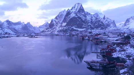 Snow-covers-a-beautiful-view-of-a-harbor-and-bay-in-a-village-in-the-Arctic-Lofoten-Islands-Norway-2