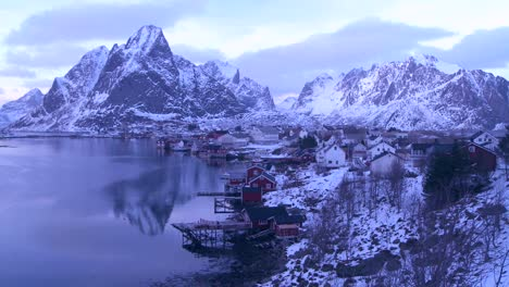 Snow-covers-a-beautiful-view-of-a-harbor-and-bay-in-a-village-in-the-Arctic-Lofoten-Islands-Norway-3