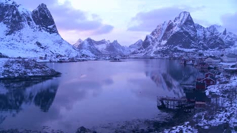 Snow-covers-a-spectacular-view-of-a-harbor-and-bay-in-a-village-in-the-Arctic-Lofoten-Islands-Norway