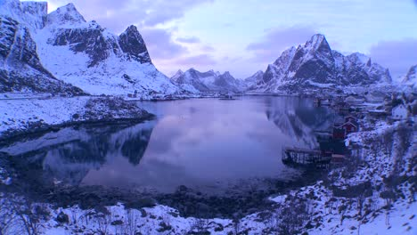 Snow-covers-a-spectacular-view-of-a-harbor-and-bay-in-a-village-in-the-Arctic-Lofoten-Islands-Norway-1