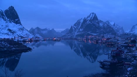 Evening-falls-on-a-beautiful-remote-village-in-the-Arctic-Lofoten-Islands-Norway