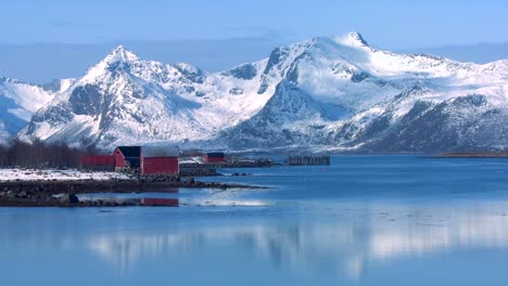Snow-covered-peaks-and-lakes-decorate-a-remote-village-in-the-Arctic-Lofoten-Islands-Norway