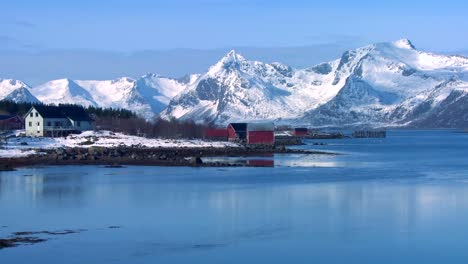 Snow-covered-peaks-and-lakes-decorate-a-remote-village-in-the-Arctic-Lofoten-Islands-Norway-1