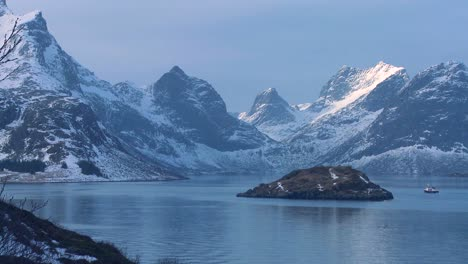 A-fishing-boat-heads-through-fjords-in-the-Arctic-Lofoten-Islands-Norway-1