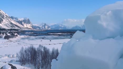 Traveling-reveal-from-an-iceberg-to-gorgeous-wintertime-fjords-north-of-the-Arctic-Circle-in-Lofoten-Islands-Norway