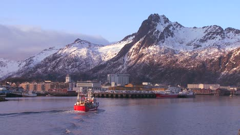 A-fishing-boat-arrives-at-Svolvaer-the-capital-city-of-the-Lofoten-islands-Norway