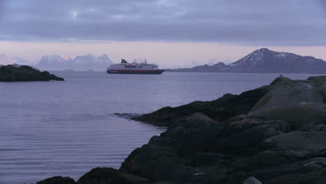 The-cruise-ship-Hurtigruten-sails-through-the-fjords-of-Norway