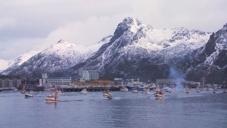 A-large-fleet-of-commercial-fishing-boats-sails-out-to-sea-of-Norway-in-the-Lofoten-Islands
