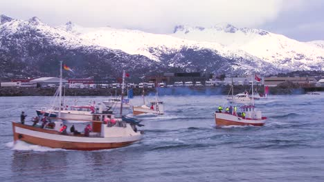 A-large-fleet-of-commercial-fishing-boats-sails-out-to-sea-of-Norway-in-the-Lofoten-Islands-1