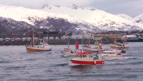 A-large-fleet-of-commercial-fishing-boats-sails-out-to-sea-of-Norway-in-the-Lofoten-Islands-2