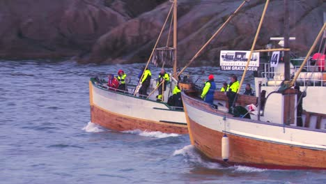 A-large-fleet-of-traditional-commercial-fishing-boats-sails-out-to-sea-of-Norway-in-the-Lofoten-Islands