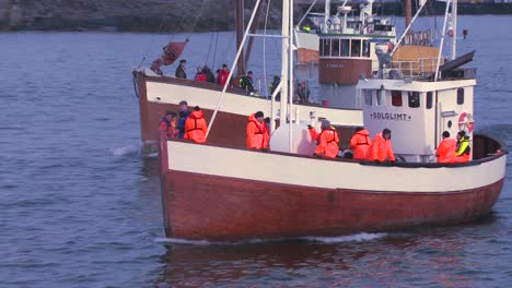 A-large-fleet-of-traditional-commercial-fishing-boats-sails-out-to-sea-of-Norway-in-the-Lofoten-Islands-3