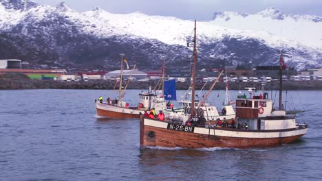 A-large-fleet-of-traditional-commercial-fishing-boats-sails-out-to-sea-from-Norway-in-the-Lofoten-Islands