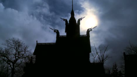 The-sun-shines-behind-a-spooky-stave-church-in-Norway-
