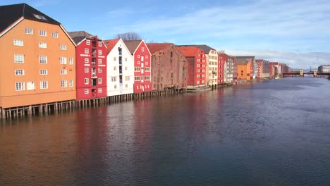 Colorful-wooden-buildings-line-the-waterfront-of-Trondheim-Norway-5