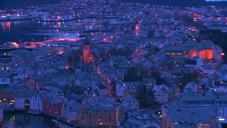 Zoom-out-from-a-high-angle-view-at-dusk-over-town-of-Alesund-Norway