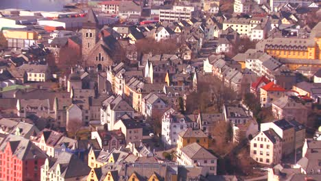 Zoom-back-from-establishing-shot-from-a-high-angle-view-over-the-town-of-Alesund-Norway