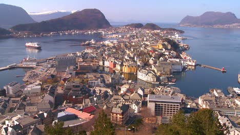 A-high-angle-view-over-the-town-of-Alesund-Norway-with-the-Hurtigruten-cruise-ship-arriving