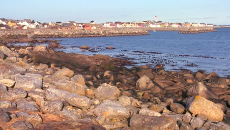 A-small-fishing-village-with-lighthouse-along-the-coast-of-Norway