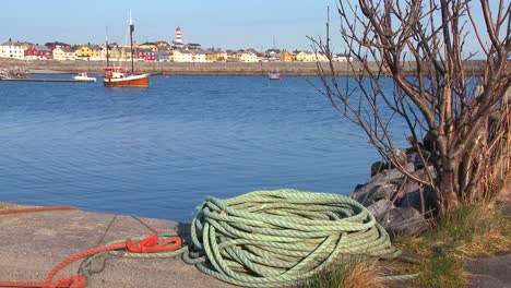 Establishing-shot-of-small-picturesque-fishing-village-with-lighthouse-along-the-coast-of-Norway