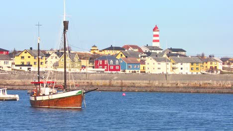 Establishing-shot-of-small-picturesque-fishing-village-with-lighthouse-along-the-coast-of-Norway-1