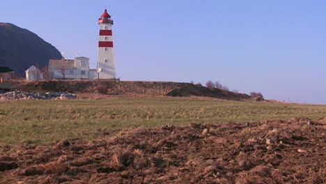 Establishing-shot-of-small-picturesque-fishing-village-with-lighthouse-along-the-coast-of-Norway-2