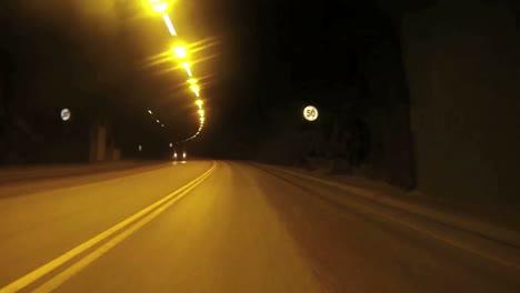 POV-shot-of-a-car-traveling-at-high-speed-through-a-tunnel-through-a-montaña-1