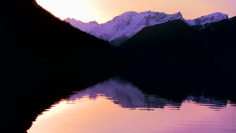 A-perfect-reflection-in-a-mountain-lake-at-sunset-1