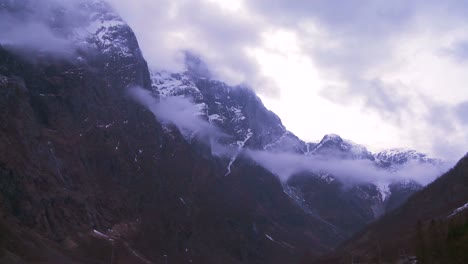 Time-lapse-of-clouds-and-fog-moving-across-a-fjord-in-Norway