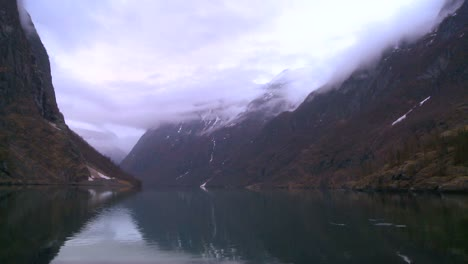 Clouds-and-fog-hang-over-a-fjord-in-Norway-in-timelapse