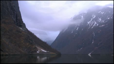 Clouds-and-fog-hang-over-a-fjord-in-Norway-in-timelapse-1