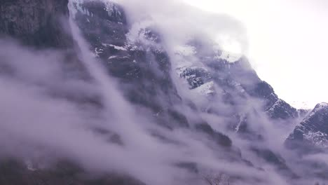 Clouds-and-fog-hang-reveal-amazing-mountains-along-a-fjord-in-Norway-1