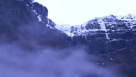 Waterfalls-plunge-from-high-cliffs-in-the-fjords-of-Norway
